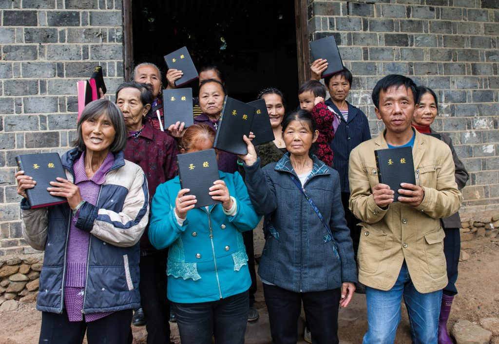 Some of the members of Luo Shui Church with Bibles they have received from Bible Societies. Thirty Christians meet regularly in this small farmhouse that serves as the building for Luo Shui Church, some of them walking for hours through the mountains each week to get here. Members can only reach the church by using stepping stones to cross a stream, and most of them are very poor.