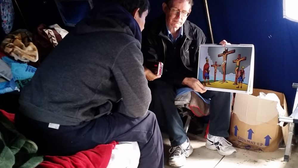 Graydon Colville presents the gospel to a Pashtun man in France.
