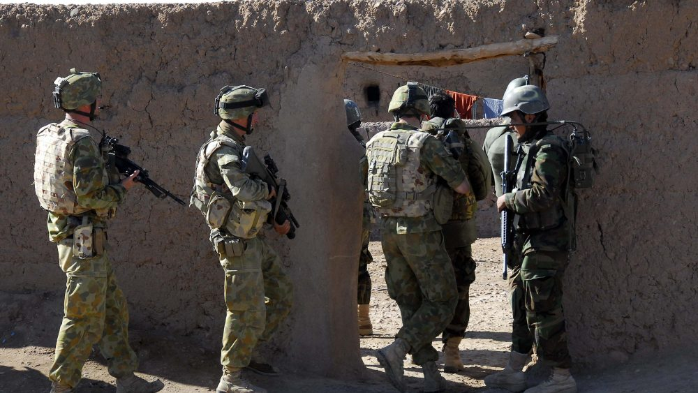 Australian and Afghan National Army soldiers work together to search the Mirabad Valley Region for weapons and Improvised Explosive Device components.