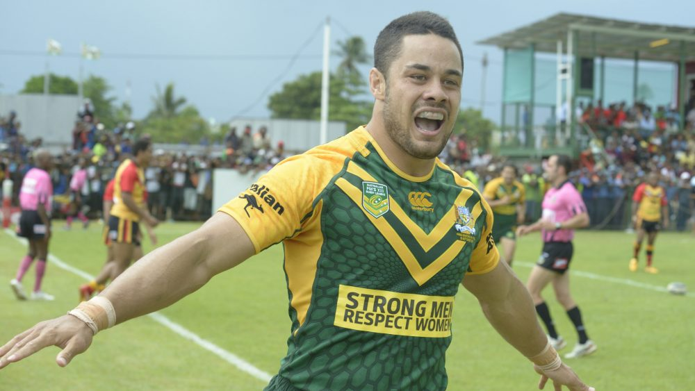 """Hayne performing the """"Hayne Plane"""" celebration while playing for the Australian Prime Minister's XIII in 2013."""
