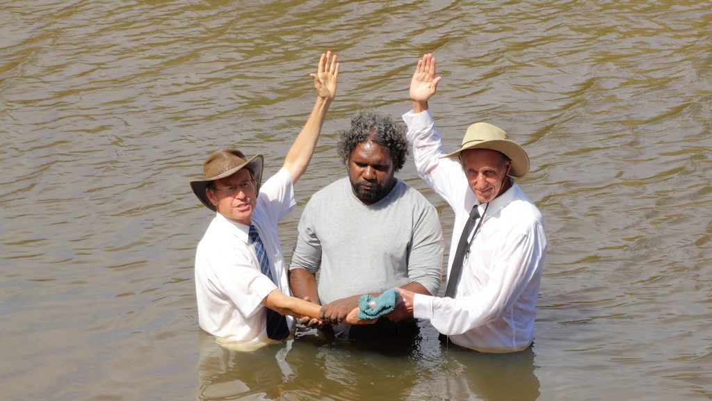 Lance Duggie is baptised by Pastors Don Fehlberg, left, David Gilmore.