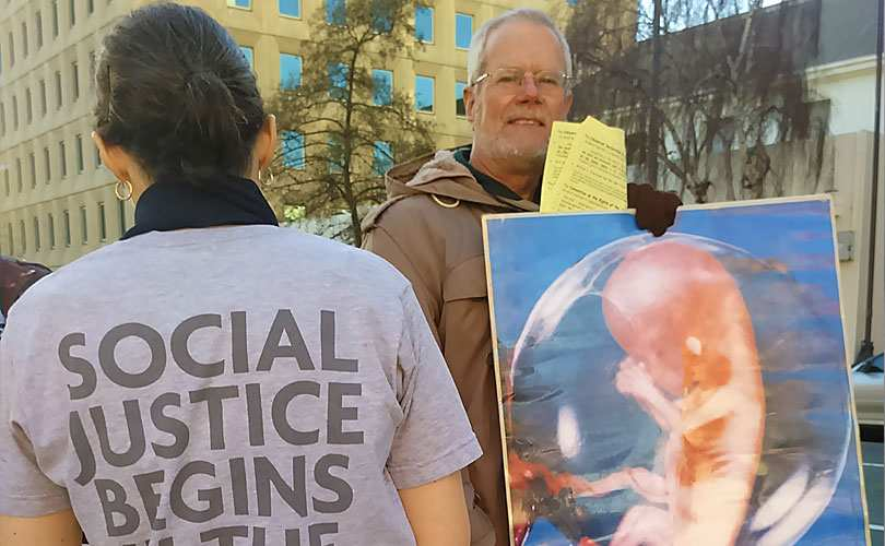 Graham Preston protests outside a Hobart abortion clinic