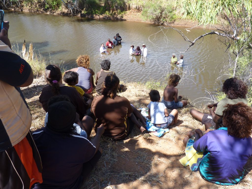 Members of the Mungkarta community enjoy the baptism scene in the McLaren River.