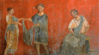 Workers put up clothes for drying in an ancient artwork from Pompeii.