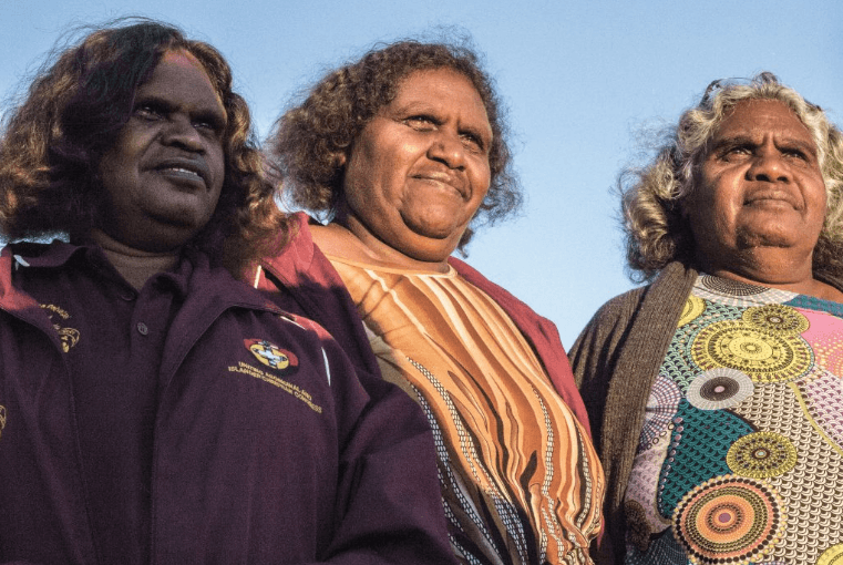 Katrina (centre) watches the sunrise over Pukatja in Central Australia with two other Pitjantjatjara translators before a day of worship and thanksgiving on Easter Sunday.