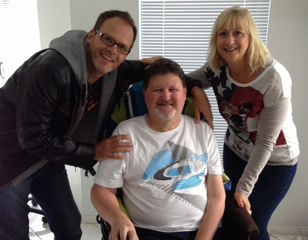 Phil Camden and his wife Lenore, visiting a friend who also has Motor Neurone Disease.