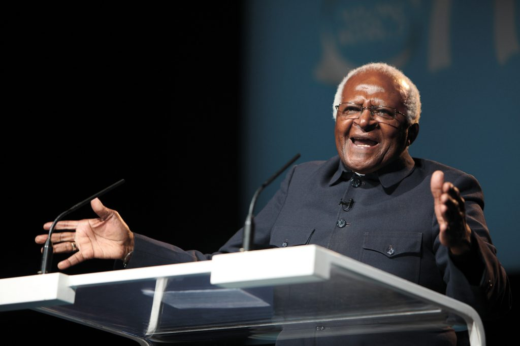 Archbishop Desmond Tutu demonstrates religion's capacity to promote reconciliation.