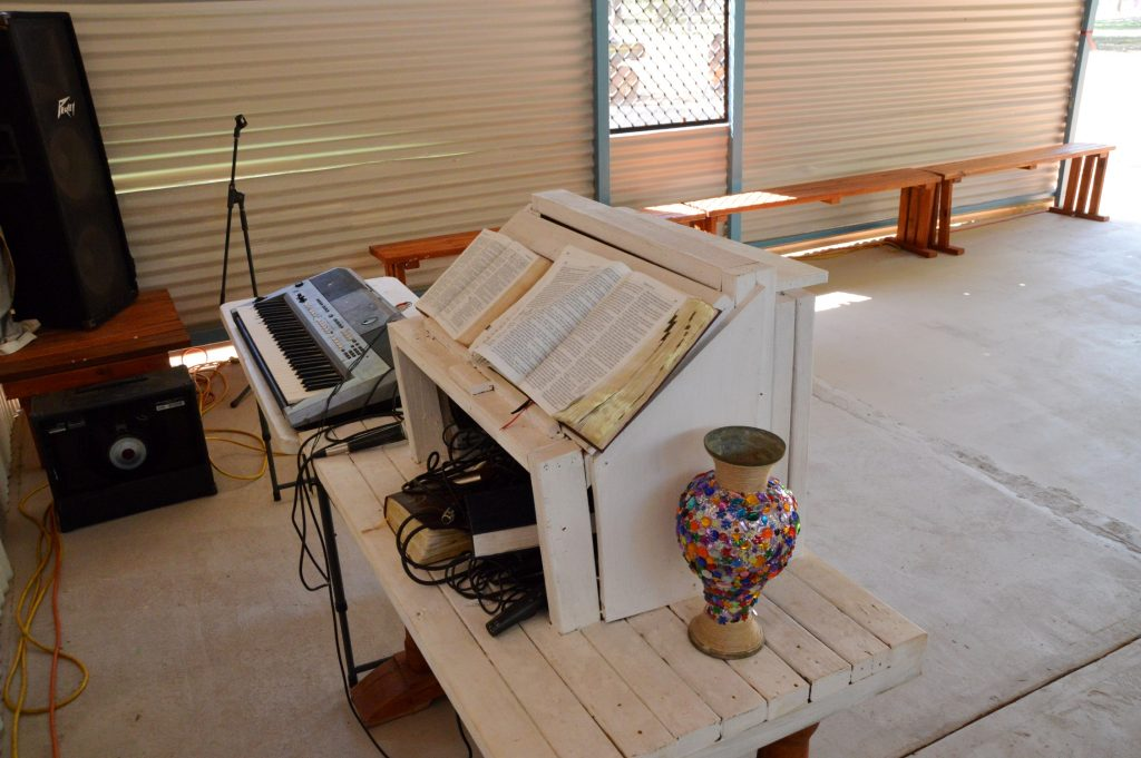 Every piece of furniture in the church is made from hand, including the pulpit, on which proudly rests a bible translated into Kriol.