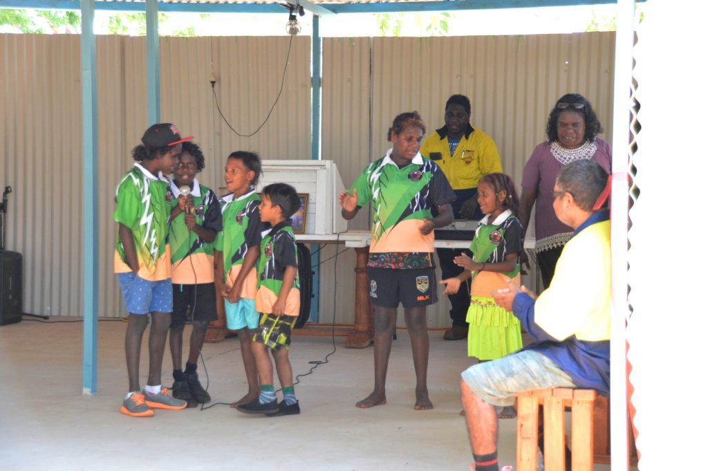 Students from Manyallaluk School mark the official opening of the tiny community's new place of worship with a Christian rap, which was taught to them by the men of the congregation.