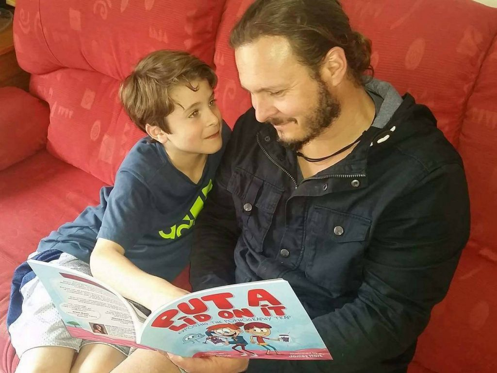 Emma's husband reads the book to their son