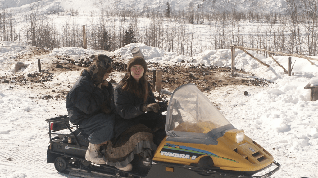 Elishaba and one of her sisters on a snow plough
