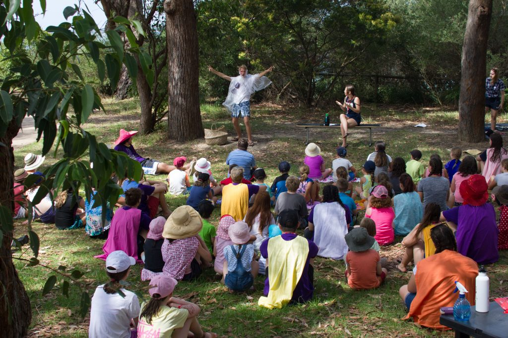 Children watch a drama at Huskisson Beach Mission on the NSW South Coast