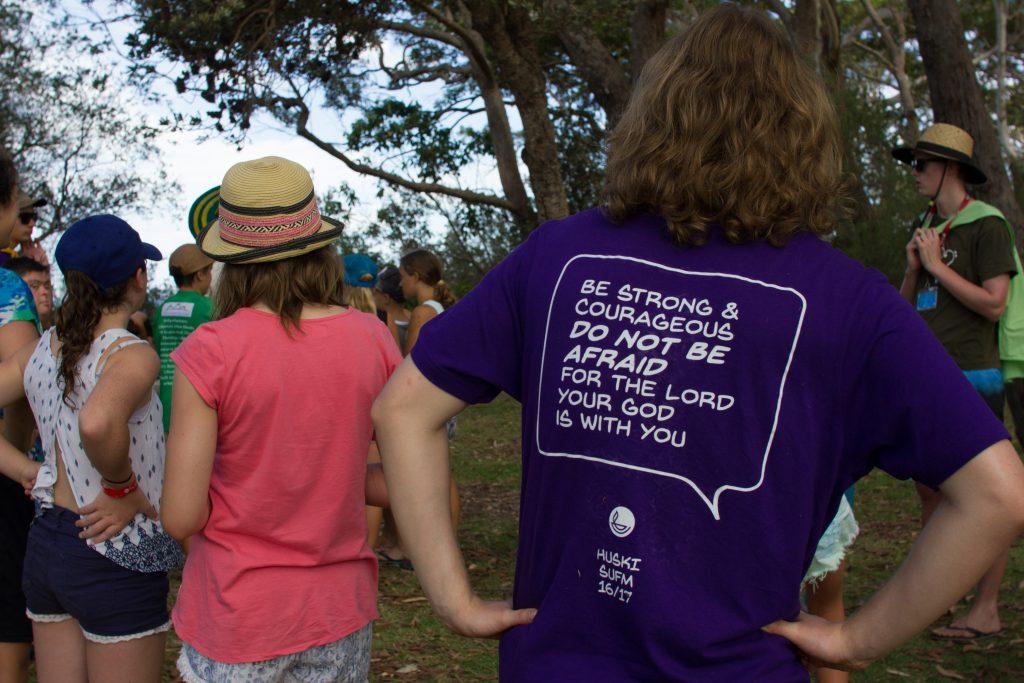 Team members wear tee shirts that proclaim God's word