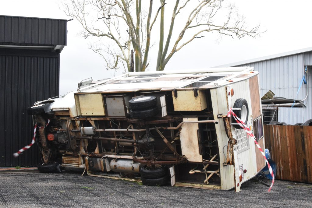 A campervan is toppled by Cyclone Debbie