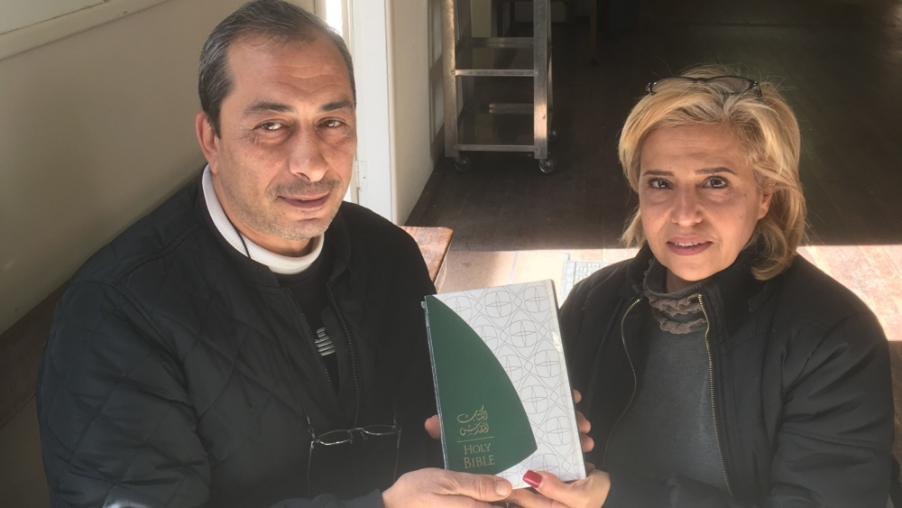 Rafi, left, and Fadia Eskeif with the Arabic-English Bible they received this week.