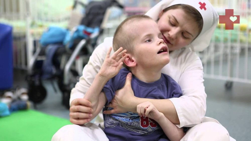 A sister of mercy takes care of a disabled child