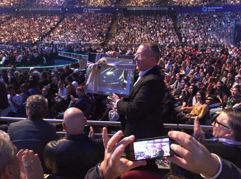 Greg Clarke receives the Bible on behalf of Bible Society Australia