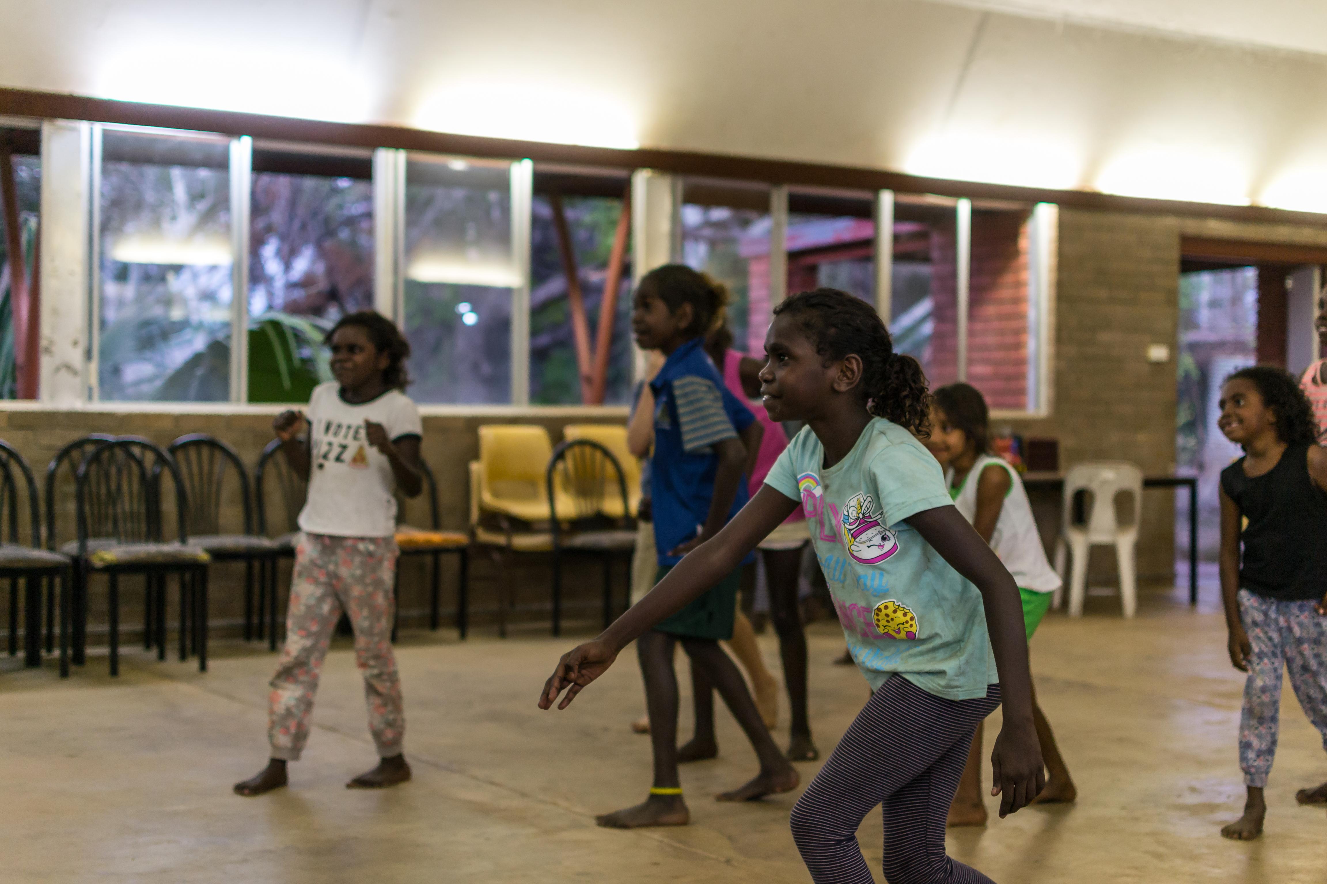 Kids play 'Red Light, Green Light' at Kids Club, Barunga