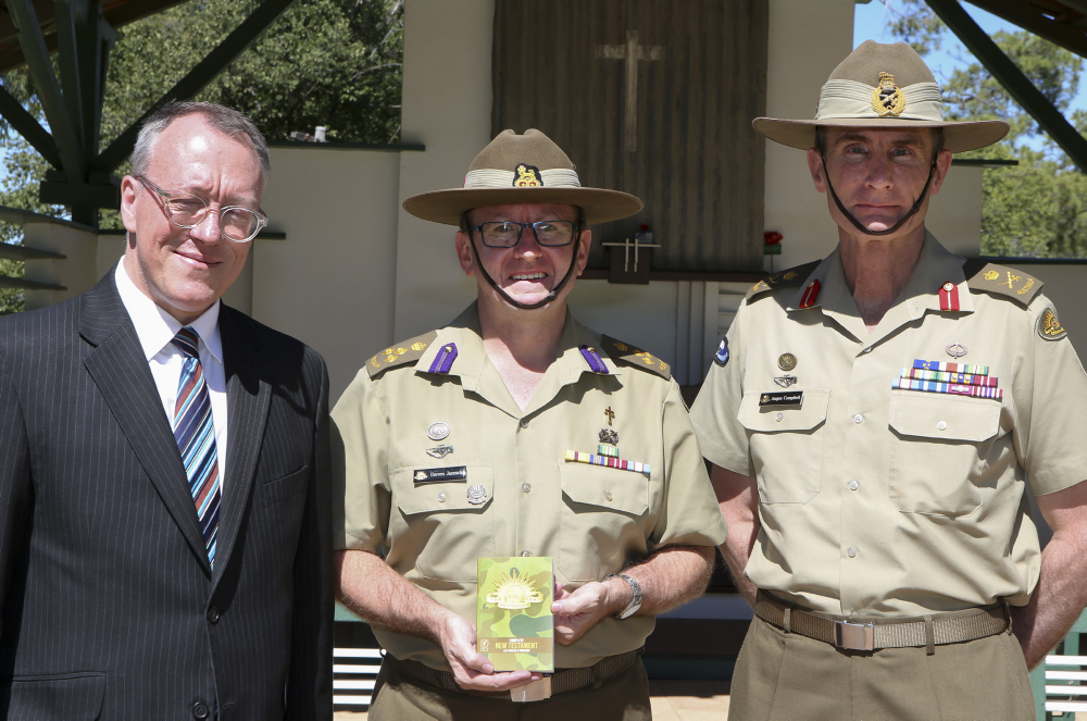 CEO of the Bible Society Dr Greg Clarke with Director General Chaplaincy - Army BRIG Darren Jaensch (centre) and Chief of Army LTGEN Angus Campbell, with the new-look camouflage Army Bible.