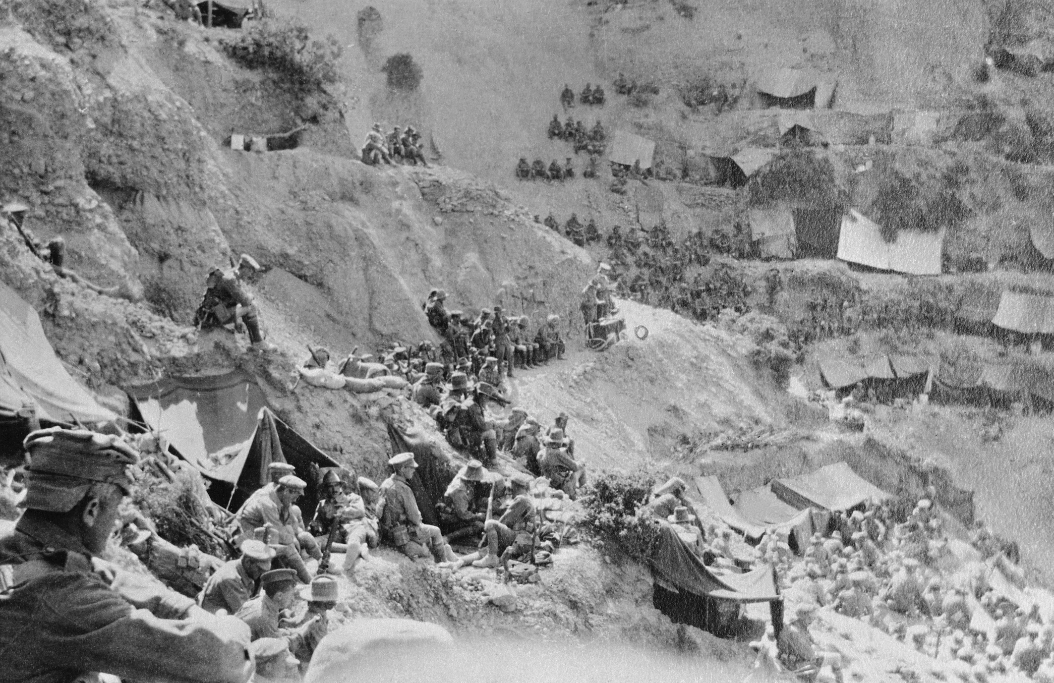 Soldiers attending a church service in Reserve Gully in Gallipoli, being conducted by Chaplain Gillison
