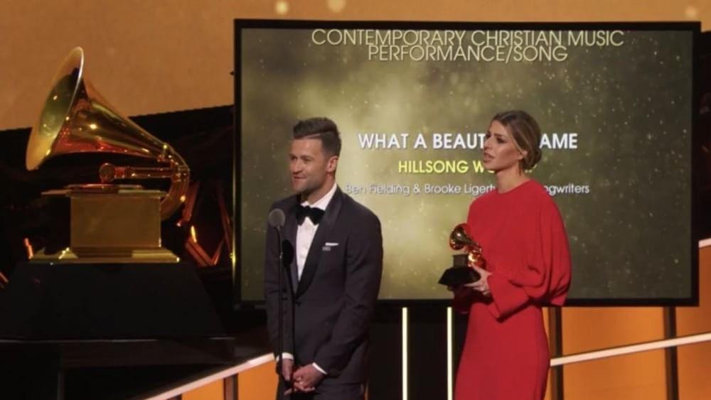 Brooke Ligertwood and Ben Fielding from Hillsong Worship accept their Grammy Award.
