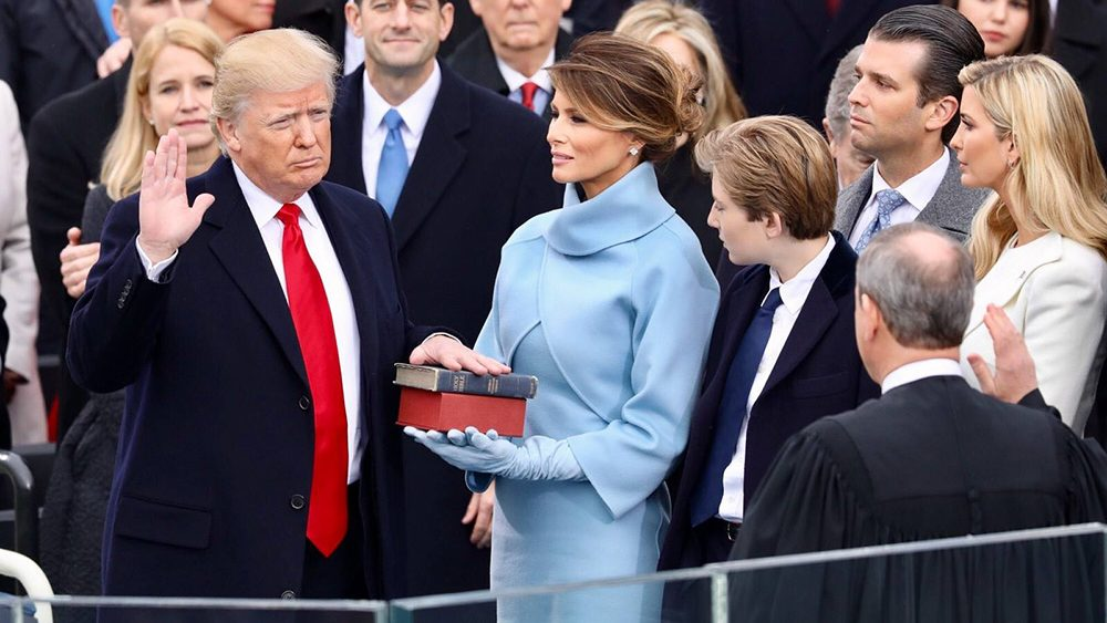 Donald Trump placing his hand on the Bible is sworn in as US President.