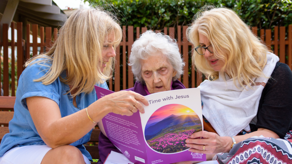 Heather, Thelma and pastoral care worker Lois Haultain reading the Faith for Life resources