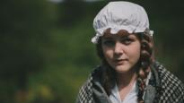 A girl dresses up as Mary Jones