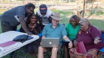 Paul Eckert (middle) with Pitjantjatjara local Bible translators working together in Ernabella (Pukatja).