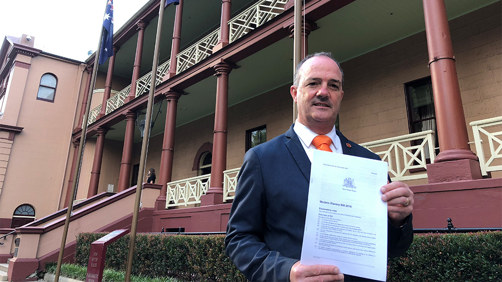 Paul Green with the Modern Slavery Bill outside the NSW parliament.