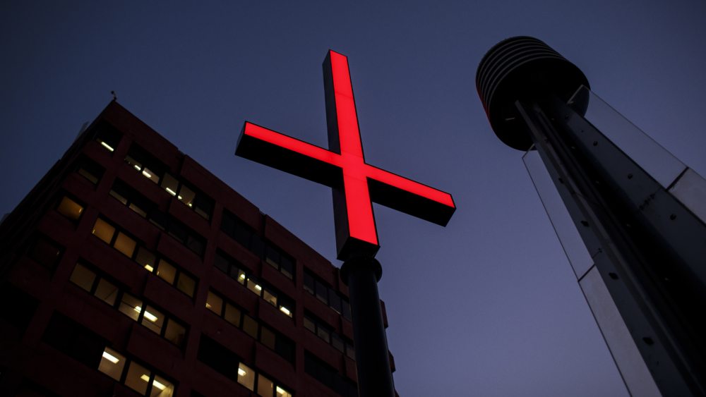 It's not Christians who should be offended by the bright-red inverted crosses, argues Michael Jensen.