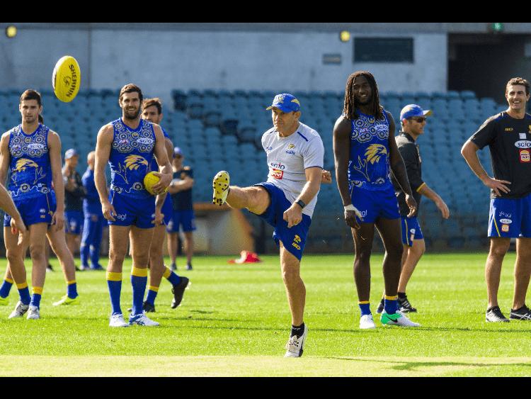 "Paul ""Morro"" Morrison kicks a ball with star player Nic Natanui at right."
