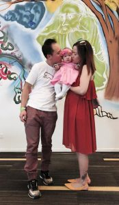 Paul Lee, six-month-old Isabella and Huyen Tran