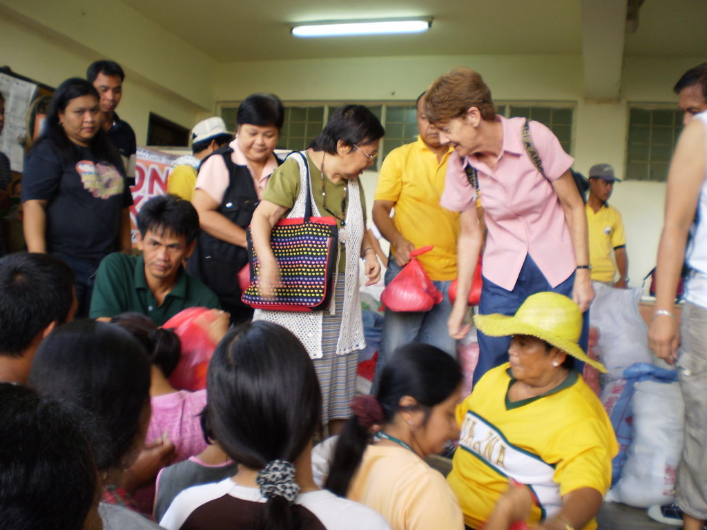Patricia Fox helps distribute aid in the Philippines.