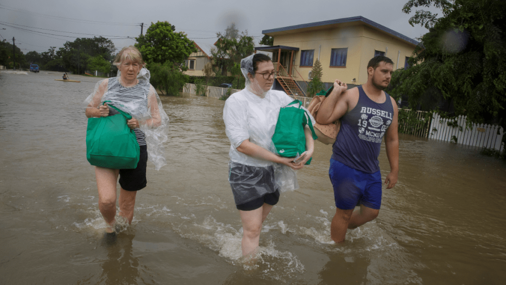 Flood-affected residents evacuate their home in Townsville.