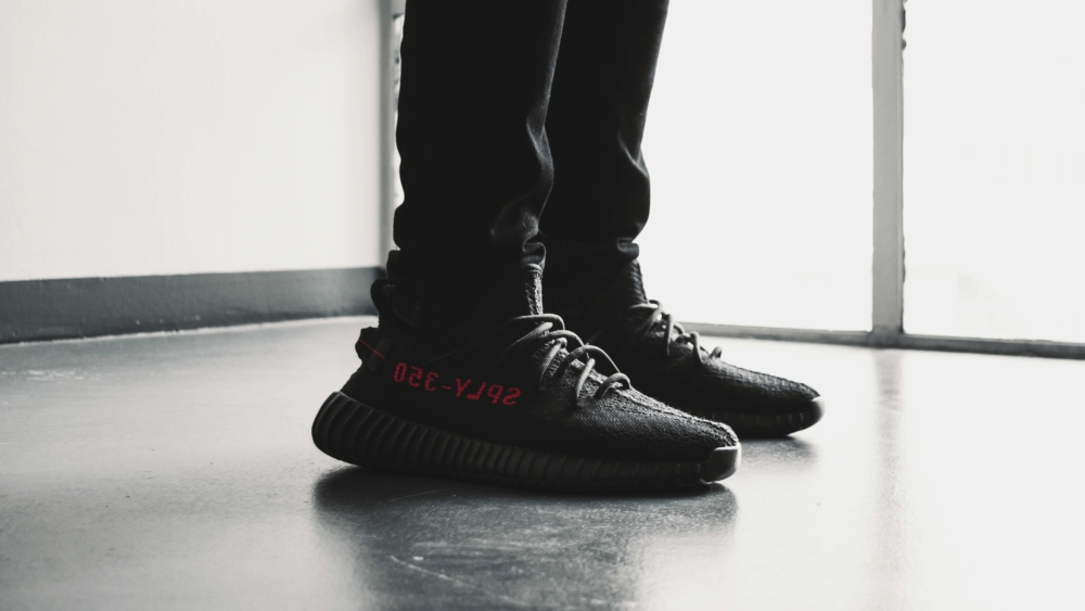 Pair of black Adidas Yeezy Boost 350 V2/ Photo: Reinhart Julian Unsplash