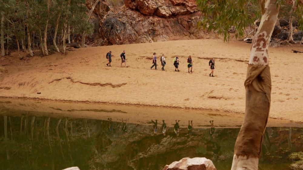 Trekkers walk the Larapinta Trail in NT