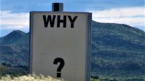 'Why' sign in mountain setting. Image: Ken Treloar / Unsplash