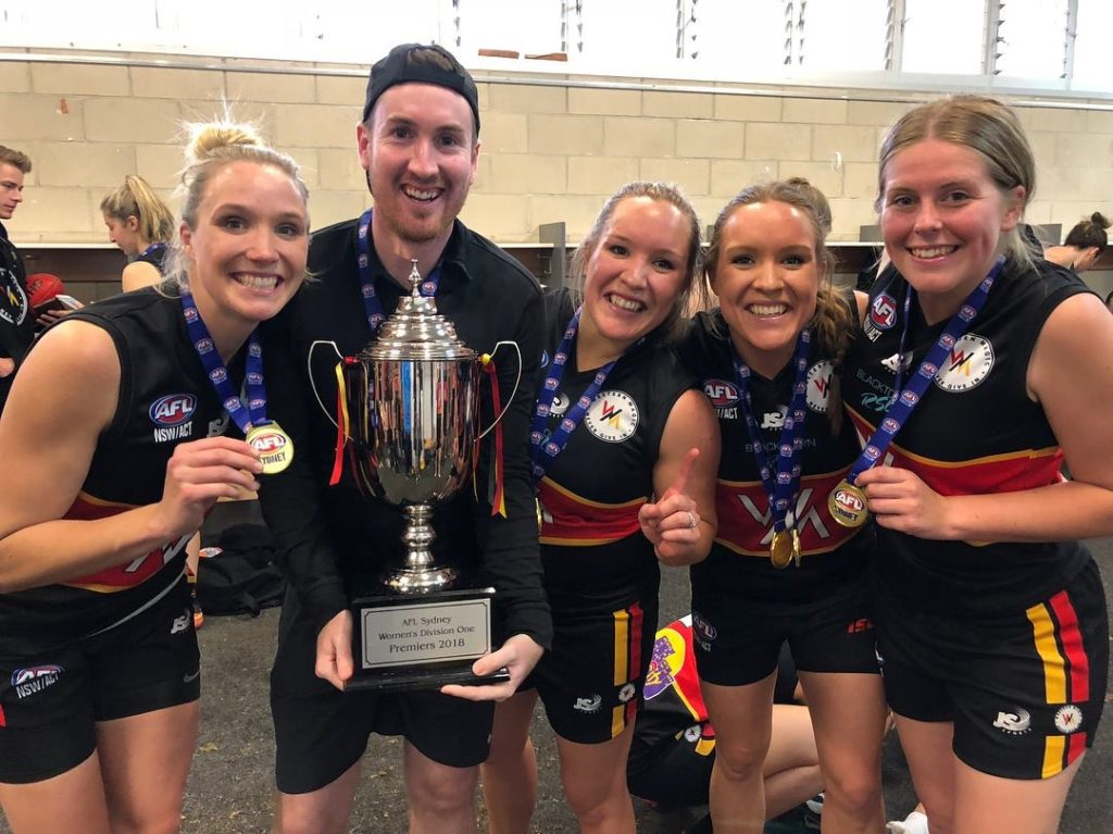 Leighton Corr with the GWS women's team that he coached to a Premiership win in 2018.
