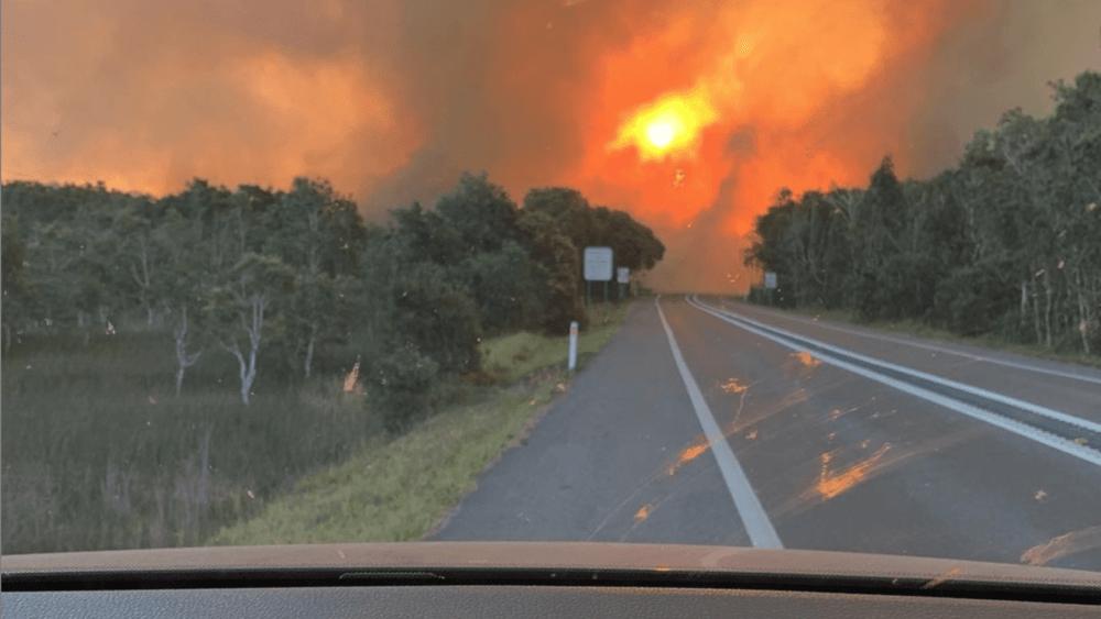 Fires approach Peregian Beach as seen from the car. Image: Jayden Clout