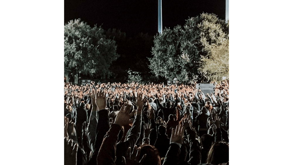 Curvine Brewington's instagram shot of hands raised in the altar call.