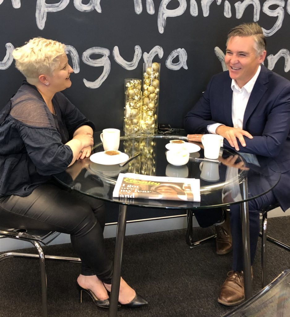 """Megan Powell du Toit and Michael Jensen tuck into a """"Tumnus cake"""" in the Eternity offices"""
