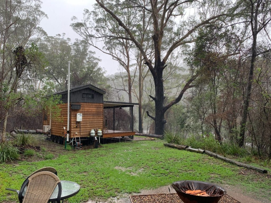 Tallarook Tiny Home Accommodation, Clyde River faced bushfire in August and flood in February when friends had to help tow the home to higher ground.
