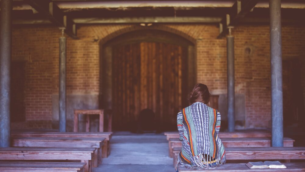 Woman in church alone