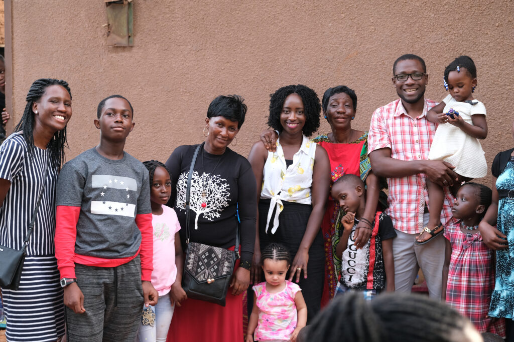 Diana (centre) with her family in Uganda