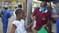 Girl with African Enterprise staffer in Kenya